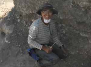 Jeremy Rimando excavates an earthen pit in Argentina