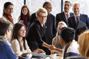 Kathleen Wynne greets student