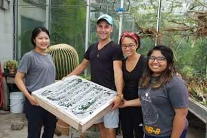 Research team members Kyungwon Ha, Peter Schnurr, Corina Ramirez and Radia Tasnim display a tray of harvested spirulina