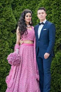 Puneet Kohli and Imre Gams pose in their wedding attire.