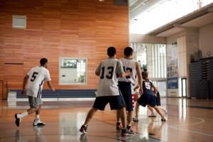 Students playing basketball in the RAWC
