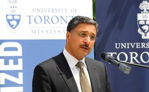 Photo of Professor Deep Saini in front of the microphone, speaking at the podium