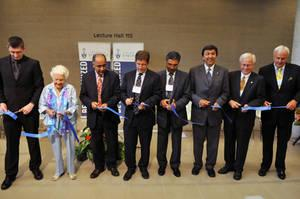 Honorable guests including Professor Deep Saini all in line cutting the ribbon.