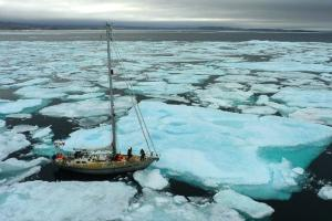 Sailboat in a sea of arctic ice