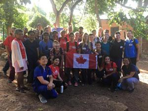 A group of students and community members pose for the camera in Honduras