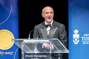 Ulrich Krull speaks at podium during 50th gala