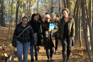 Fiona Rawle taking students on walking office hours in the forest