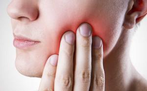 stock image of man feeling pain in mouth or jaw