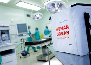 hospital operating room and white organ donation box with red lettering