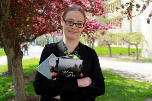 Rachele Marchand holding three books