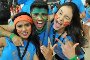 three university students with facepaint smling