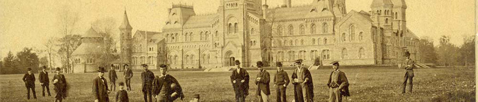 Men standing in front of University College circa 1880