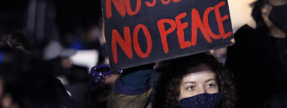 People participate in protest against police violence.
