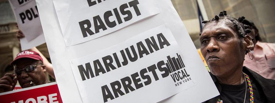 People protest racially biased arrests related to marijuana possession.