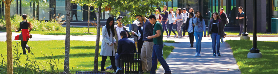 Image of students gathered outside of the Instructional Building who are enjoying the green space