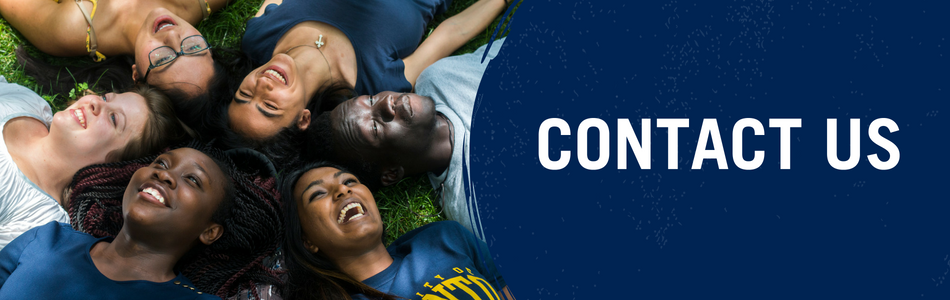 Contact Us. Banner. Six students laying down on a grass field smiling.