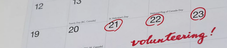 "Calendar with 3 dates circled in red and the word ""volunteering"" written across."