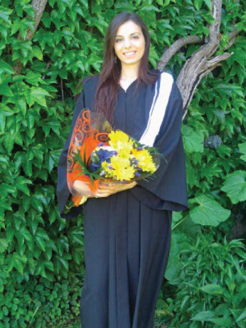 convocation picture, Amani dressed in gown with flowers