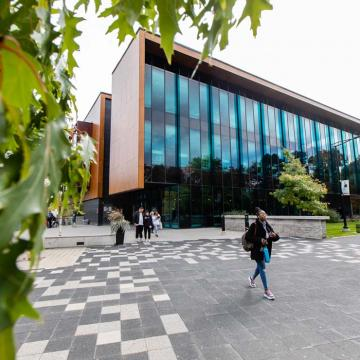 Students roaming the UTM campus in the fall season