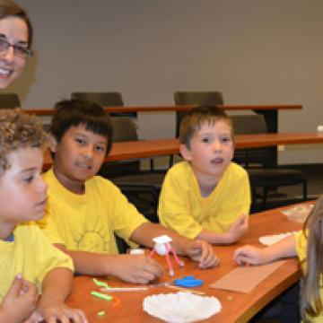 Jenna Friedt (in blue) with camp kids from Sunshine Children's Centre