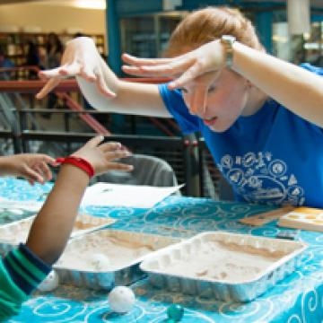 Science Rendezvous volunteer Olivia Adamczyk and budding scientist